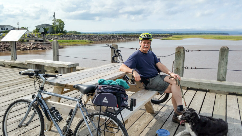 Steve, resting with Joni, beside the Minas Basin, in Wolfville, the first 10 km done comfortably.